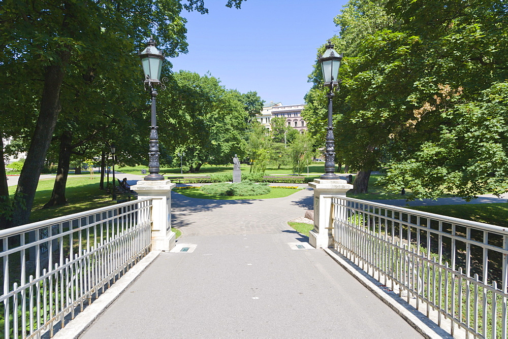 Pedestrian bridge in Bastejkalns Park, old town, Vecriga, Riga, Latvia, Northern Europe