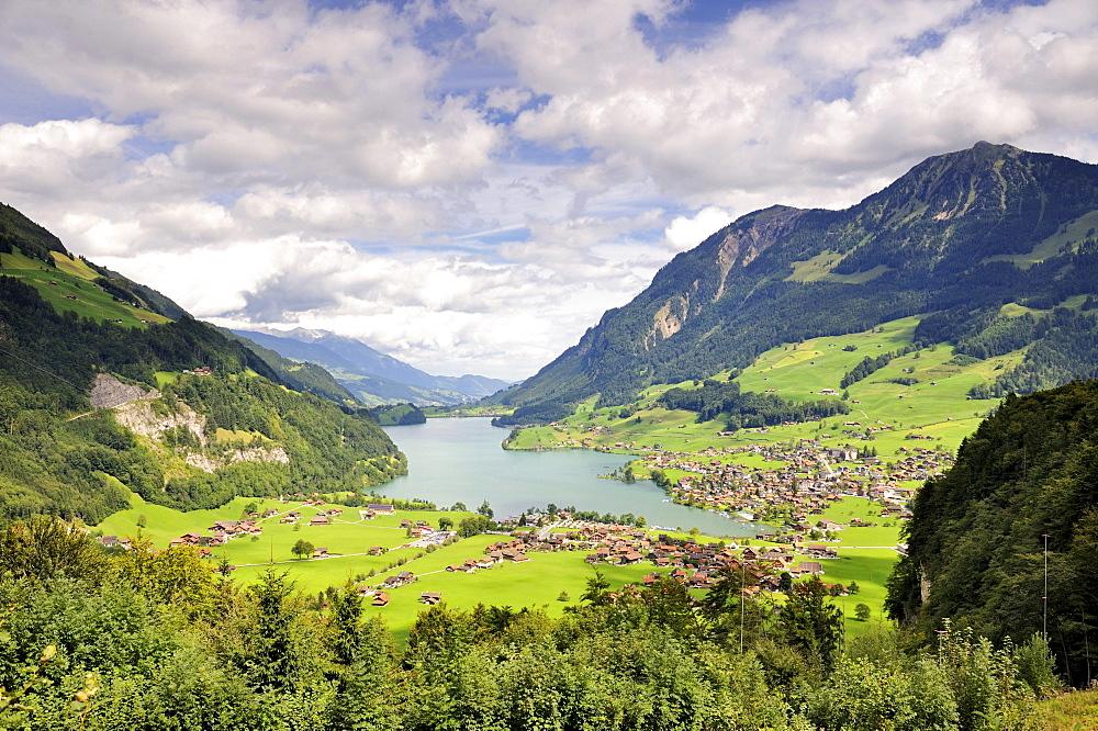 View over Lungernsee Lake into Sameraatal valley, a natural dam below the Bruenigpass, Canton of Obwalden, Switzerland, Europe