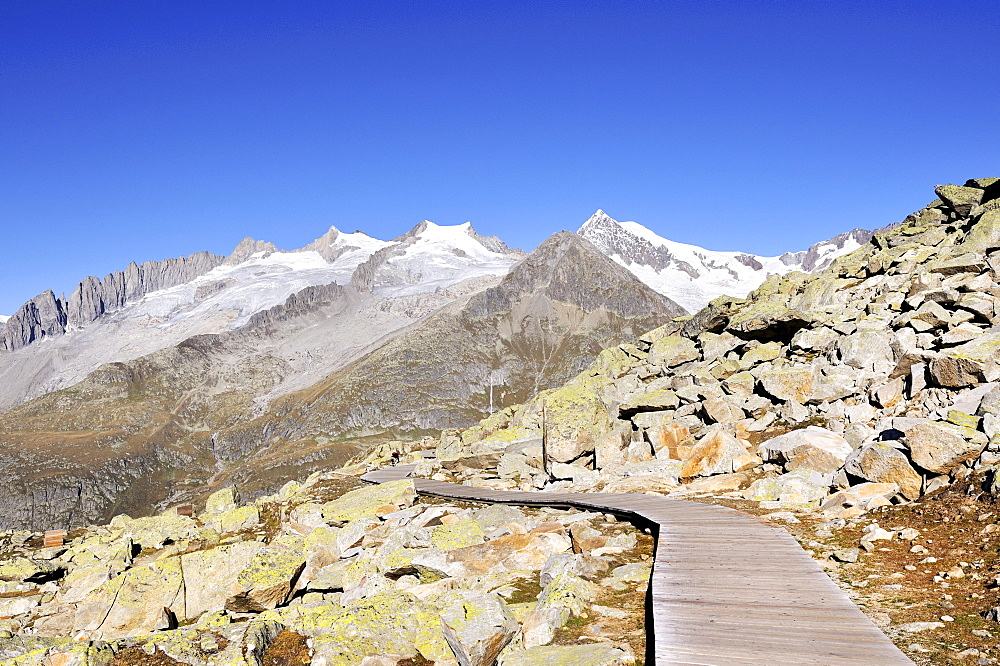 Wooden track for wheelchair access on Bettmerhorn Mountain, 2872 metres high, leading to the observation deck above the Aletsch Glacier, Canton of Valais, Switzerland, Europe