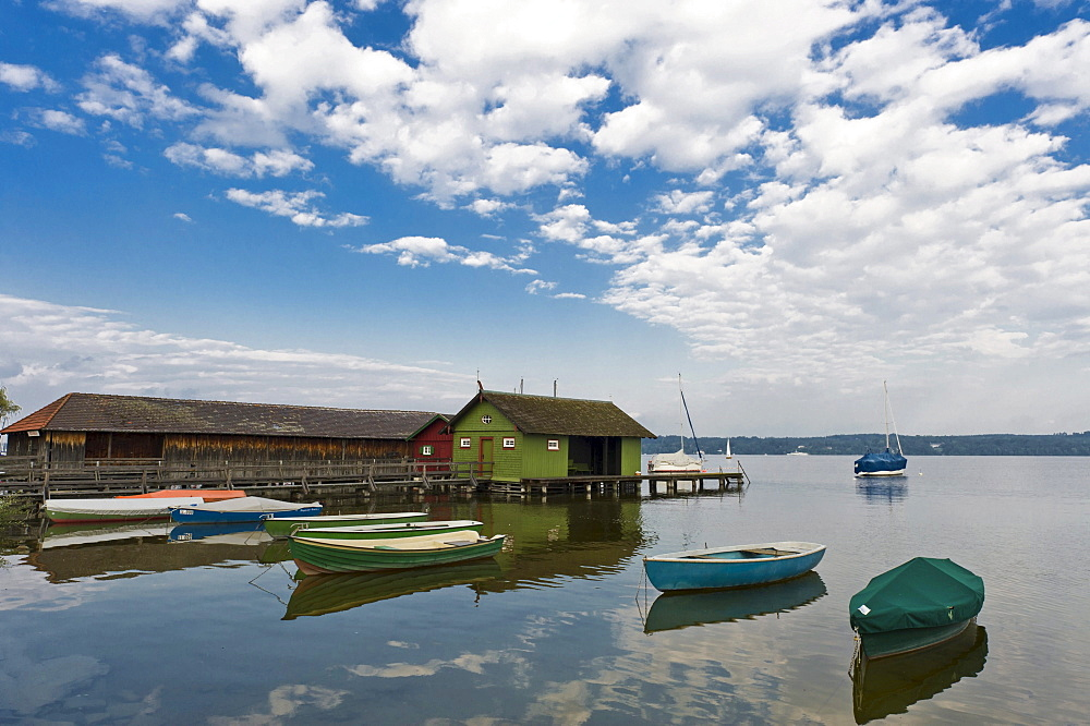 Boathouses and small boats on the Lake Ammersee at Schondorf, Bavaria, Germany, Europe