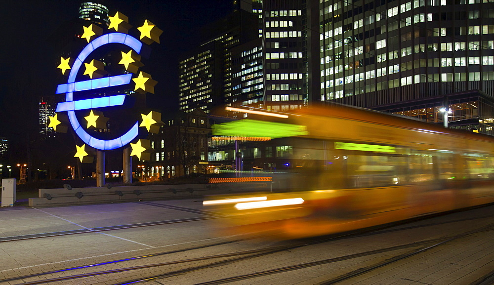 Tram passing the euro sign in front of the ECB, European Central Bank, Frankfurt am Main, Hesse, Germany, Europe