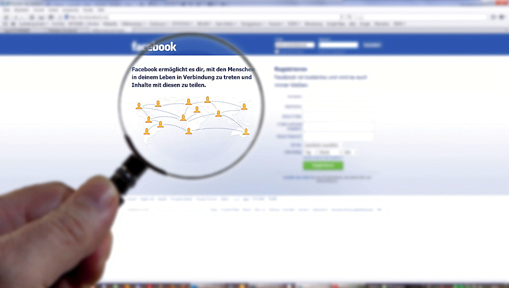 Searching for information on Facebook with a magnifying glass