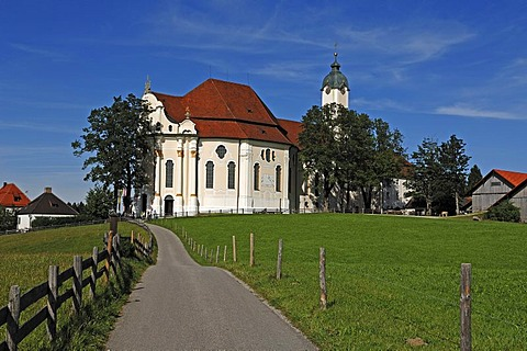 Pilgrimage Church of Wies with pastures and a blue sky, Wies 12, Steingaden, Upper Bavaria, Bavaria, Germany, Europe