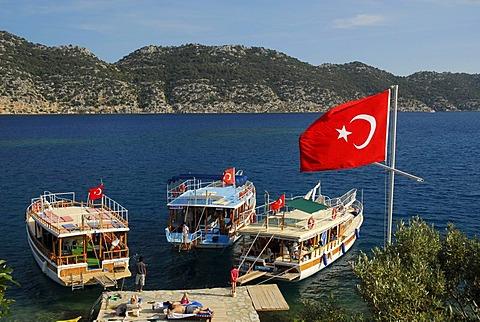 Turkish flag and boats on the quayside, village of Kale, Kalekoey or Simena, Kekova Bay, Lycian coast, Antalya Province, Mediterranean, Turkey, Eurasia