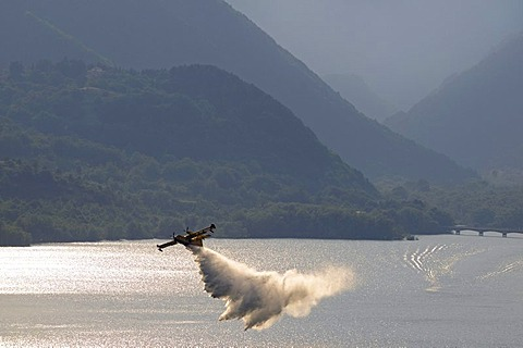 Fire fighting aircraft training on Lake Lago di Barrea, Abruzzo, Italy, Europe