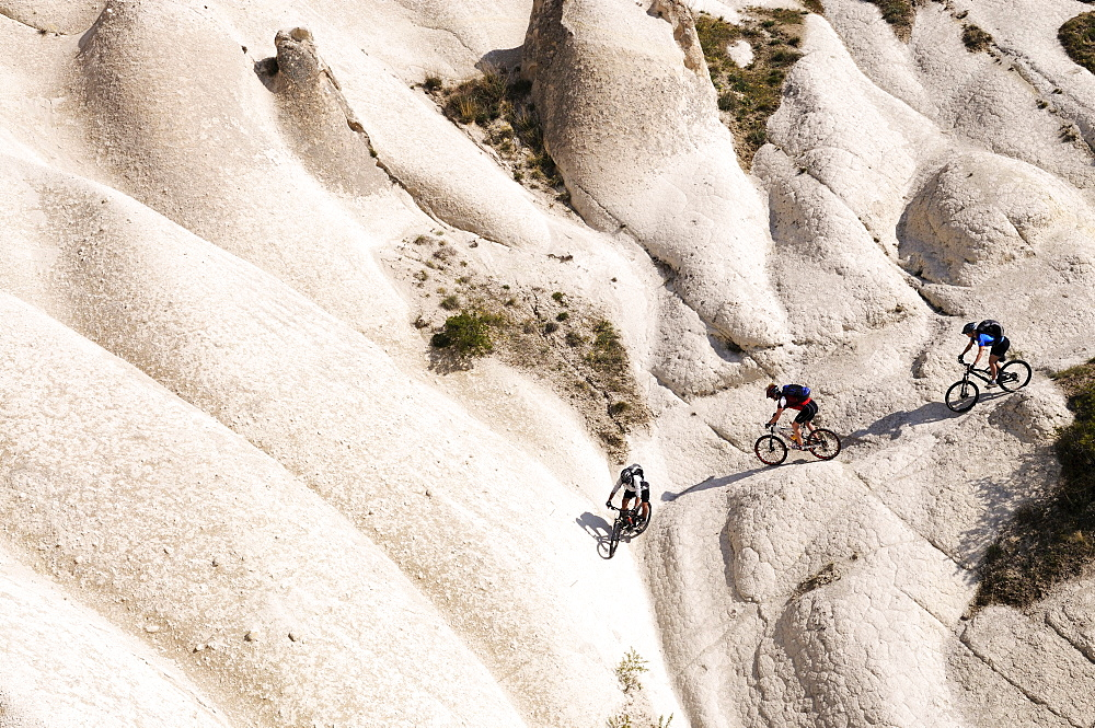 Mountain bikers cycling in Goereme, Cappadocia, Turkey - 832-131096
