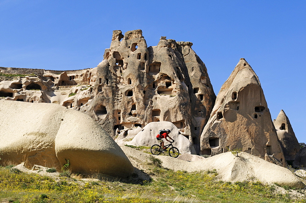 Mountain bikers in the Rose Valley, Uchisar, Goereme Valley, Cappadocia, Turkey, Western Asia