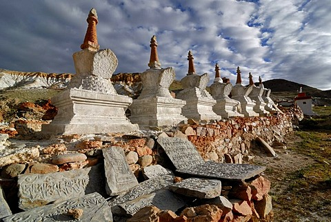 Tibetan Mani Stones in front of Chorten or Stupas at the holy pilgrimage site of Thirtapuri, Mount Kailash, Ngari Province, western Tibet, Tibet, China, Asia