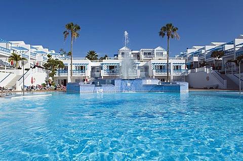 Swimming pool in a hotel, Atlantis Las Lomas Apartments, Puerto del Carmen, Lanzarote, Canary Islands, Spain, Europe