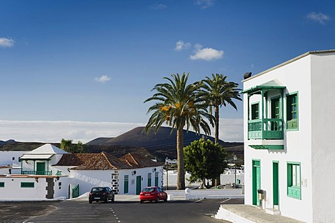 House with a typical Canarian balcony and date palms in Yaiza, Lanzarote, Canary Islands, Spain, Europe