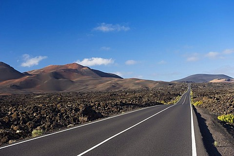 Road through the volcanic landscape in Montana del Fuego de Timanfaya National Park, Lanzarote, Canary Islands, Spain, Europe