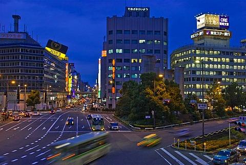 Neon lights and traffic blur at dusk, Umeda, Osaka, Japan, Asia