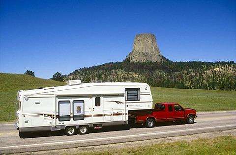 Pick up with trailer in front of Devils Tower, Wyoming, USA