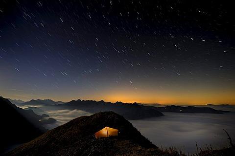Tent on a peak af the blue hour, Allgaeu Alps, Kleinwalsertal valley, Vorarlberg, Austria, Europe