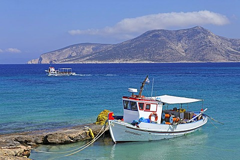 Fishing boat on Koufonisi island, Kato Koufonisi in the back, Cyclades, Aegean Sea, Greece, Europe
