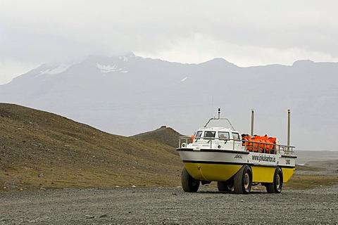 Amphibious vehicle in Jokulsarlon glacial lagoon, South coast, Iceland, Europe