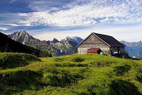 Hiking weather in late summer with a view overlooking the alm, alpine pasture, in Arvenbuehl towards Glaernisch Mountain, Canton of Glarus, Switzerland, Europe