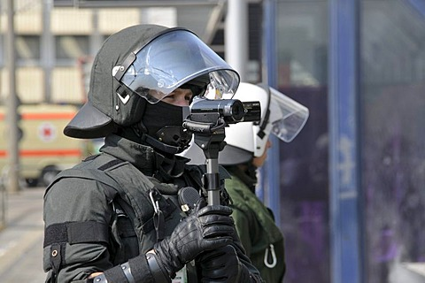 Police officer with a video camera filming his colleagues on duty at a NPD rally in Ulm, Baden-Wuerttemberg, Germany, Europe