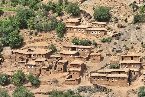 Typical Berber village with traditional adobe houses and small kasbahs in the mountains of the High Atlas, Morocco, Africa