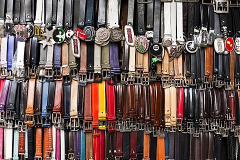 Leather belts at a market in Florence, Tuscany, Italy, Europe