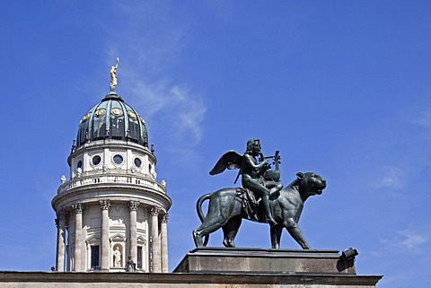 Statue of the genius of the music riding on a panther, on the roof of Konzerthaus Berlin, dome of French Cathedral at back, Gendarmenmarkt, Mitte district, Berlin, Germany, Europe