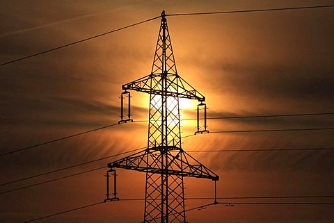 Electricity pylon at sunrise