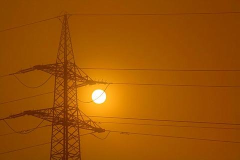 Electricity pylon at dawn
