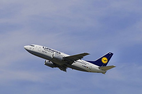 Boeing 737-500 airline from Lufthansa climbing in front of cirrostratus clouds