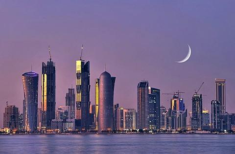 Twilight shot, skyline of Doha, Tornado Tower, Navigation Tower, Peace Towers, Al-Thani Tower, Moon, Doha, Qatar, Persian Gulf, Middle East, Asia