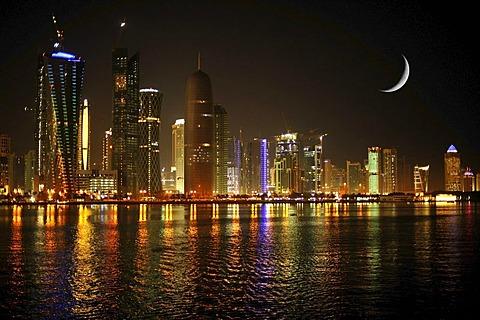 Night shot, skyline of Doha, Tornado Tower, Navigation Tower, Peace Towers, Al-Thani Tower, Moon, Doha, Qatar, Qatar, Persian Gulf, Middle East, Asia