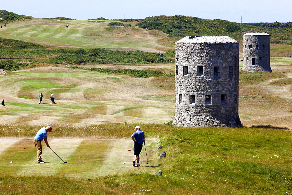 Royal Guernsey Golf Club, Martello towers, watch towers and fortified towers built in the 17th century, next to the fairways, at Pembroke bay in the northeast of the Channel Island of Guernsey, Europe