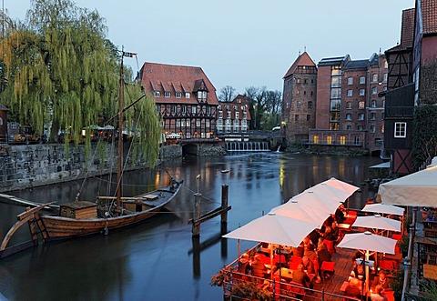 Historical salt port on the Ilmenau river, evening mood, illuminated restaurant terraces, Lueneburg, Lower Saxony, Germany, Europe