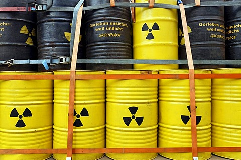 Symbolic nuclear waste barrels stacked on a loading platform, anti-nuclear demonstration against the Gorleben disposal site, Lueneburg, Lower Saxony, Germany, Europe