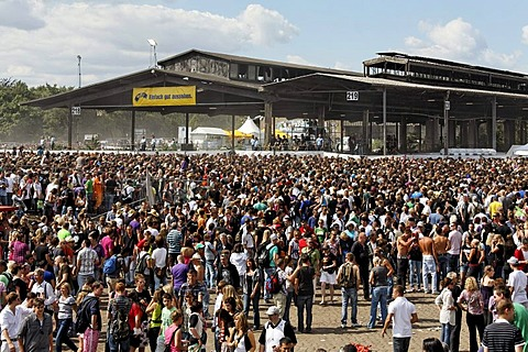 Crowds outside the derelict buildings of an old freight depot, Loveparade 2010, Duisburg, North Rhine-Westfalia, Germany, Europe