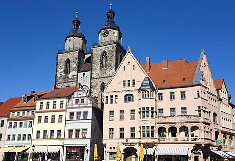 Towers of the church of St. Marien and restored houses in Lutherstadt Wittenberg, Saxony-Anhalt, Germany, Europe