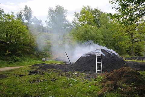 Burning charcoal kiln, Walpersdorf, Siegen-Wittgenstein region, North Rhine-Westphalia, Germany, Europe
