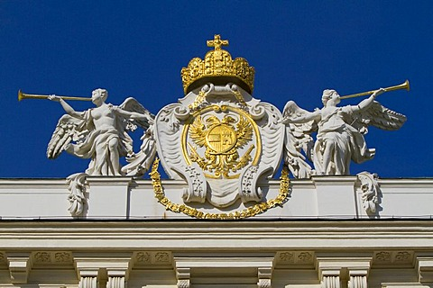 Sculptures with the imperial crown and coat of arms on the roof of the Hofburg Imperial Palace, Vienna, Austria, Europe
