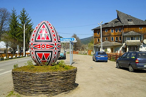 Oversized Easter egg as a sign to the Moldova convent, Vorone& Monastery, Eastern Carpathians, Romania, Europe - 832-146688