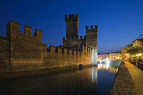 Castello Scaligero Scaliger Castle at night in Sirmione, Lake Garda, Lombardy, Italy, Europe