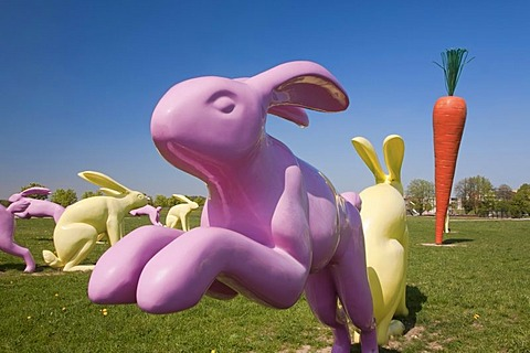 Bunny sculptures arranged around a carrot sculpture, Scharnhauser Park district, Ostfildern, Baden-Wuerttemberg, Germany, Europe