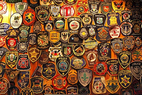 Police badges, O'Connor's Pub, Doolin, County Clare, Ireland, Europe