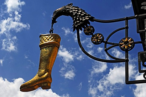 Hanging boot with eagle, advertising sign of a shoe store, Hochstrasse 8, Mittenwald, Upper Bavaria, Bavaria, Germany, Europe