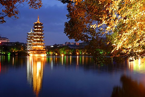 Shanhu Lake with brightly lit pagodas, Sun and Moon Pagodas, Chinese city of Guilin, Guangxi, China, Asia