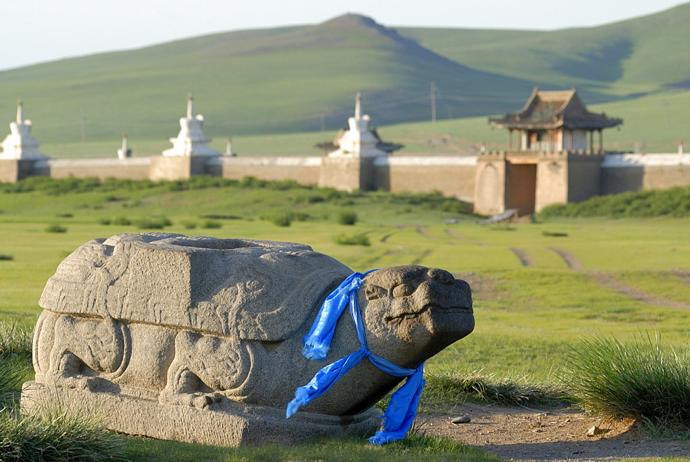 Stone turtle with a blue ribbon, Khata, guard, located in front of the stupa of the outer wall of the Erdene Zuu Khiid Monastery, Karakorum, Kharkhorin, Oevoerkhangai province, Mongolia, Asia