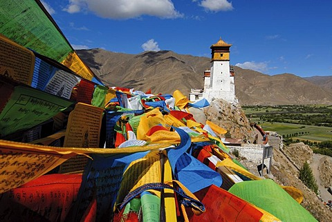 Prayer flags flying above the Yarlung valley on Yumbulagang Palace, first and oldest fortress in Tibet, Himalayas, Central Tibet, Tibet, China, Asia
