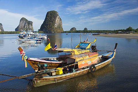 Karst rock formations and fishing boats in the Bay of Pakmeng, Trang, Thailand, Southeast Asia, Asia