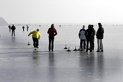 Bavarian game of Eisstock, ice stock, on frozen lake Chiemsee, Chiemgau, Upper Bavaria, Germany, Europe