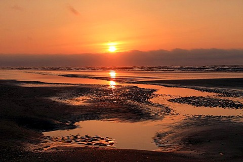Red coastal sunset filtered through volcanic ash, Juist, Lower Saxony, Germany, Europe