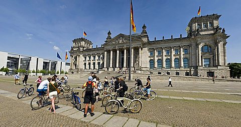 Panoramic view of tourists on bicycles in front of the Reichstag or German Parliament Buildings, Berlin, Germany, Europe