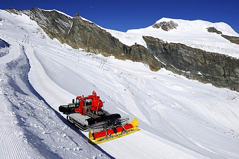 Snowcat on Mt. Mittelallalin, the summer ski resort of Saas Fee, Valais, Switzerland, Europe
